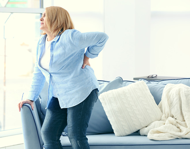 DMC-woman-back-pain-659x519-featured-image